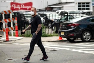 BOSTON, MA - JULY 1: Christian Vazquez #7 of the Boston Red Sox arrives in advance of a training period before the start of the 2020 Major League Baseball season on July 1, 2020 at Fenway Park in Boston, Massachusetts. The season was delayed due to the coronavirus pandemic. (Photo by Billie Weiss/Boston Red Sox/Getty Images) *** Local Caption *** Christian Vazquez