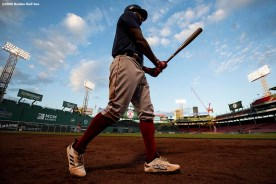 BOSTON, MA - JULY 17: Xander Bogaerts #2 of the Boston Red Sox warms up on deck during an intra squad game during a summer camp workout before the start of the 2020 Major League Baseball season on July 17, 2020 at Fenway Park in Boston, Massachusetts. The season was delayed due to the coronavirus pandemic. (Photo by Billie Weiss/Boston Red Sox/Getty Images) *** Local Caption *** Xander Bogaerts