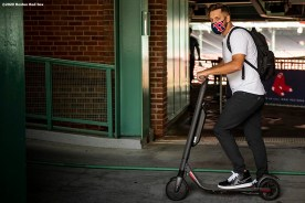 BOSTON, MA - JULY 24: Matt Hall #56 of the Boston Red Sox arrives on a scooter before the Opening Day game against the Baltimore Orioles on July 24, 2020 at Fenway Park in Boston, Massachusetts. The 2020 season had been postponed since March due to the COVID-19 pandemic. (Photo by Billie Weiss/Boston Red Sox/Getty Images) *** Local Caption *** Matt Hall