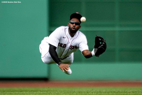 BOSTON, MA - JULY 25: Jackie Bradley Jr. #19 of the Boston Red Sox makes a diving catch during the fifth inning of a game against the Baltimore Orioles on July 25, 2020 at Fenway Park in Boston, Massachusetts. The Major League Baseball season was delayed due to the coronavirus pandemic. (Photo by Billie Weiss/Boston Red Sox/Getty Images) *** Local Caption *** Jackie Bradley Jr.