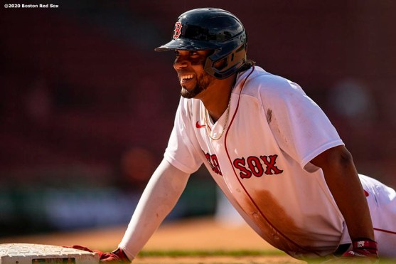 BOSTON, MA - JULY 26: Xander Bogaerts #2 of the Boston Red Sox reacts after hitting an RBI single during the sixth inning of a game against the Baltimore Orioles on July 26, 2020 at Fenway Park in Boston, Massachusetts. The 2020 season had been postponed since March due to the COVID-19 pandemic. (Photo by Billie Weiss/Boston Red Sox/Getty Images) *** Local Caption *** Rafael Devers