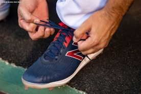 BOSTON, MA - AUGUST 7: Mitch Moreland #18 of the Boston Red Sox ties his New Balance cleat before a game against the Toronto Blue Jays on August 7, 2020 at Fenway Park in Boston, Massachusetts. The 2020 season had been postponed since March due to the COVID-19 pandemic. (Photo by Billie Weiss/Boston Red Sox/Getty Images) *** Local Caption *** Mitch Moreland