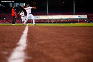 BOSTON, MA - AUGUST 10: Jonathan Arauz #36 of the Boston Red Sox warms up before a game against the Tampa Bay Rays on August 10, 2020 at Fenway Park in Boston, Massachusetts. The 2020 season had been postponed since March due to the COVID-19 pandemic. (Photo by Billie Weiss/Boston Red Sox/Getty Images) *** Local Caption *** Jonathan Arauz