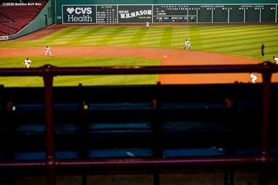 BOSTON, MA - AUGUST 10: Members of the Boston Red Sox play defense during a game against the Tampa Bay Rays on August 10, 2020 at Fenway Park in Boston, Massachusetts. The 2020 season had been postponed since March due to the COVID-19 pandemic. (Photo by Billie Weiss/Boston Red Sox/Getty Images) *** Local Caption ***
