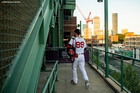 BOSTON, MA - AUGUST 11: Alex Verdugo #99 of the Boston Red Sox walks toward the field before a game against the Tampa Bay Rays on August 11, 2020 at Fenway Park in Boston, Massachusetts. The 2020 season had been postponed since March due to the COVID-19 pandemic. (Photo by Billie Weiss/Boston Red Sox/Getty Images) *** Local Caption *** Alex Verdugo