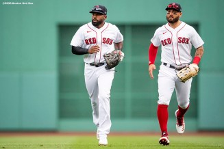 BOSTON, MA - AUGUST 19: Jackie Bradley Jr. #19 and Kevin Pillar #5 of the Boston Red Sox run off the field during the first inning of a game against the Philadelphia Phillies on August 19, 2020 at Fenway Park in Boston, Massachusetts. The 2020 season had been postponed since March due to the COVID-19 pandemic. (Photo by Billie Weiss/Boston Red Sox/Getty Images) *** Local Caption *** Jackie Bradley Jr.; Kevin Pillar