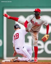 BOSTON, MA - AUGUST 19: Didi Gregorius #3 of the Philadelphia Phillies wears a mask as he turns a double play over Mitch Moreland #18 of the Boston Red Sox during the second inning of a game on August 19, 2020 at Fenway Park in Boston, Massachusetts. The 2020 season had been postponed since March due to the COVID-19 pandemic. (Photo by Billie Weiss/Boston Red Sox/Getty Images) *** Local Caption *** Didi Gregorius; Mitch Moreland