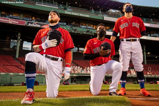 BOSTON, MA - AUGUST 28: Alex Verdugo #99 and Jackie Bradley Jr. #19 of the Boston Red Sox kneel alongside Michael Chavis #23 during the National Anthem during a pre-game ceremony in recognition of Jackie Robinson Day before a game against the Washington Nationals on August 28, 2020 at Fenway Park in Boston, Massachusetts. The 2020 season had been postponed since March due to the COVID-19 pandemic. (Photo by Billie Weiss/Boston Red Sox/Getty Images) *** Local Caption *** Alex Verdugo; Jackie Bradley Jr.; Michael Chavis