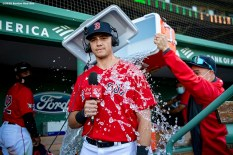 BOSTON, MA - AUGUST 30: Bobby Dalbec #29 of the Boston Red Sox is doused with Gatorade after his Major League Baseball debut game against the Washington Nationals on August 30, 2020 at Fenway Park in Boston, Massachusetts. The 2020 season had been postponed since March due to the COVID-19 pandemic. (Photo by Billie Weiss/Boston Red Sox/Getty Images) *** Local Caption *** Bobby Dalbec