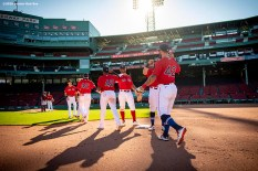 BOSTON, MA - AUGUST 30: Members of the Boston Red Sox celebrate a victory against the Washington Nationals on August 30, 2020 at Fenway Park in Boston, Massachusetts. The 2020 season had been postponed since March due to the COVID-19 pandemic. (Photo by Billie Weiss/Boston Red Sox/Getty Images) *** Local Caption ***