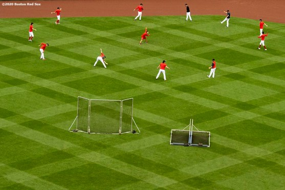 BOSTON, MA - AUGUST 31: Members of the Boston Red Sox stretch before a game against the Atlanta Braves on August 31, 2020 at Fenway Park in Boston, Massachusetts. The 2020 season had been postponed since March due to the COVID-19 pandemic. (Photo by Billie Weiss/Boston Red Sox/Getty Images) *** Local Caption ***