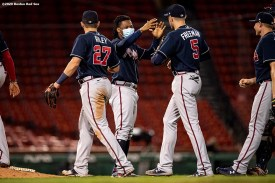 BOSTON, MA - AUGUST 31: Members of the Atlanta Braves celebrate a victory against the Boston Red Sox on August 31, 2020 at Fenway Park in Boston, Massachusetts. The 2020 season had been postponed since March due to the COVID-19 pandemic. (Photo by Billie Weiss/Boston Red Sox/Getty Images) *** Local Caption ***