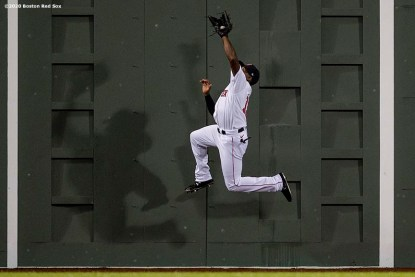 BOSTON, MA - SEPTEMBER 2: Jackie Bradley Jr. #19 of the Boston Red Sox leaps as he catches a fly ball during the second inning of a game against the Atlanta Braves on September 2, 2020 at Fenway Park in Boston, Massachusetts. The 2020 season had been postponed since March due to the COVID-19 pandemic. (Photo by Billie Weiss/Boston Red Sox/Getty Images) *** Local Caption *** Jackie Bradley Jr.