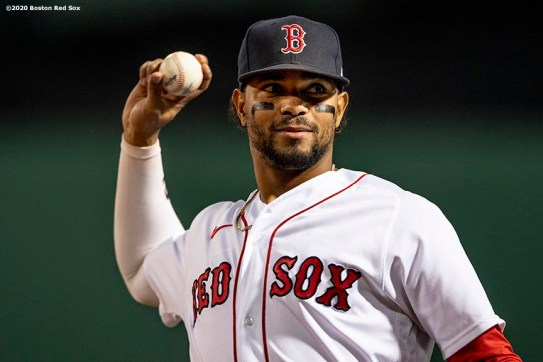 BOSTON, MA - SEPTEMBER 18: Xander Bogaerts #2 of the Boston Red Sox throws before a game against the New York Yankees on September 18, 2020 at Fenway Park in Boston, Massachusetts. The 2020 season had been postponed since March due to the COVID-19 pandemic. (Photo by Billie Weiss/Boston Red Sox/Getty Images) *** Local Caption *** Xander Bogaerts
