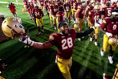 CHESTNUT HILL, MA - SEPTEMBER 26: John Lamot #28 of the Boston College Eagles runs onto the field as he celebrates a victory against the Texas State Bobcats at Alumni Stadium on September 26, 2020 in Chestnut Hill, Massachusetts. (Photo by Billie Weiss/Getty Images) *** Local Caption *** John Lamot
