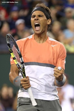 """Rafael Nadal reacts after winning a point during a match against Radek Stepanek in the second round of the 2014 BNP Paribas Open Saturday, March 8, 2014 in Indian Wells, California."""