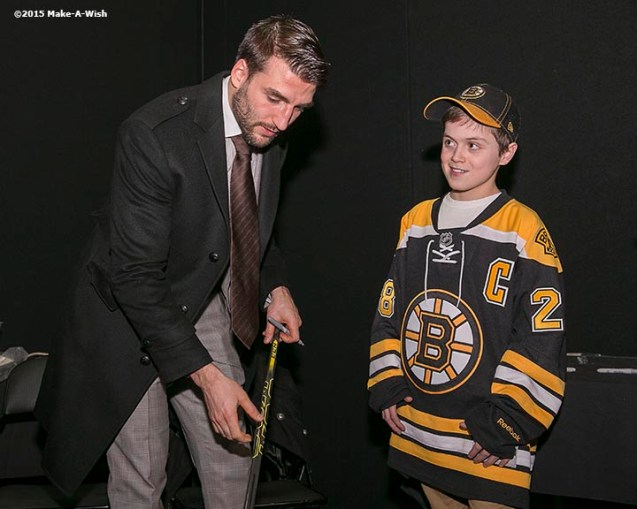"""Make-A-Wish recipient Jimmy Bjorkman of West Salem, Wisconsin meets Boston Bruins player Patrice Bergeron and is given one of his hockey sticks after a hockey game between the Boston Bruins and the Montreal Canadiens at TD Garden in Boston, Massachusetts Sunday, February 8, 2015."""