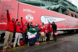 """Members of the Boston Red Sox fan services department pose for a photograph in front of the truck during Boston Red Sox truck day Thursday, February 12, 2015 at Fenway Park in Boston, Massachusetts."""