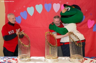 """A resident reacts as he is greeted by mascot Wally the Green Monster and former Boston Red Sox player Ted Lepcio during a Boston Red Sox Valentine's Day caravan to retirement and assisted living communities throughout greater Boston Friday, February 13, 2015."""