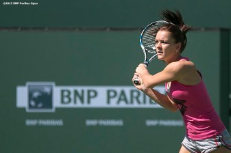 """Agnieszka Radwanska hits a backhand during a practice session on Stadium 1 at the Indian Wells Tennis Garden in Indian Wells, California Friday, March 6, 2015."""