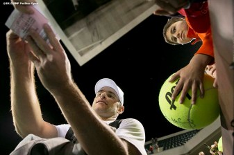 """Andy Roddick signs autographs during the McEnroe Challenge for Charity presented by Masimo in Stadium 2 at the Indian Wells Tennis Garden in Indian Wells, California Saturday, March 7, 2015."""