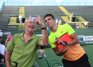 """Borna Coric poses with a fan after a first round qualifying match at the Indian Wells Tennis Garden in Indian Wells, California Tuesday, March 10, 2015."""