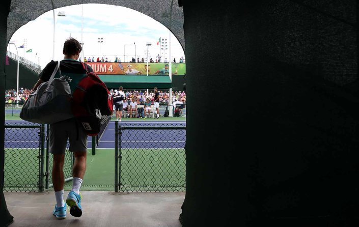 """Roger Federer walks to the court before practicing at the Indian Wells Tennis Garden in Indian Wells, California Tuesday, March 11, 2015."""
