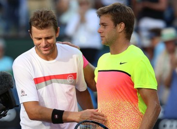 """Mardy Fish and Ryan Harrison greet each other following their match inside Stadium 1 at the Indian Wells Tennis Garden in Indian Wells, California Tuesday, March 12, 2015."""