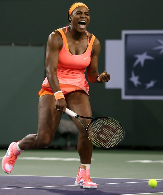 """Serena Williams in action against Monica Niculescu during their match at Stadium 1 at the Indian Wells Tennis Garden in Indian Wells, California on Friday, March 13, 2015."""