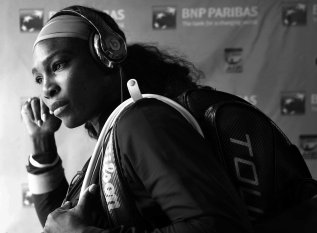 """Serena Williams walks through the tunnel prior to her match against Zarina Diyas at stadium 1 at the Indian Wells Tennis Garden in Indian Wells, California on Sunday, March 15, 2015."""