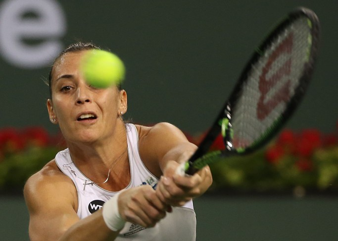"""Flavia Pennetta in action against Maria Sharapova at stadium 1 at the Indian Wells Tennis Garden in Indian Wells, California on Tuesday, March 17, 2015."""