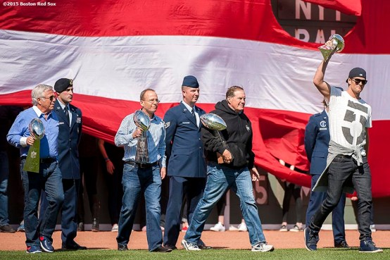 """New England Patriots quarterback Tom Brady, head coach Bill Belichick, President Jonathan Kraft and owner Robert Kraft are introduced with the Super Bowl trophies during a pre-game ceremony before the Boston Red Sox 2015 home opener against the Washington Nationals Monday, April 13, 2015 at Fenway Park in Boston, Massachusetts."""