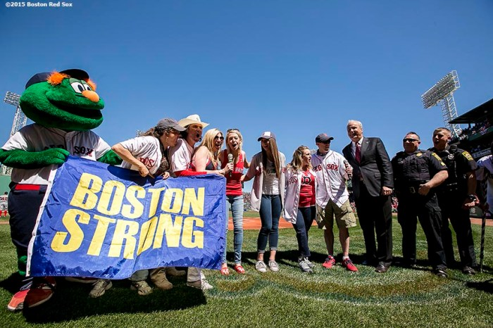"""Boston Marathon survivors announce 'Play Ball' before a game against the Washington Nationals at Fenway Park in Boston, Massachusetts Wednesday, April 15, 2015."""