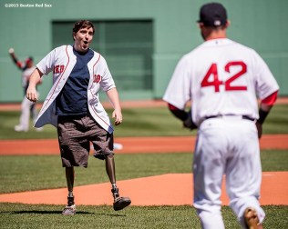 """Boston Marathon bombing survivors Jeff Bauman reacts after throwing out the ceremonial first pitch before a game against the Washington Nationals at Fenway Park in Boston, Massachusetts Wednesday, April 15, 2015."""