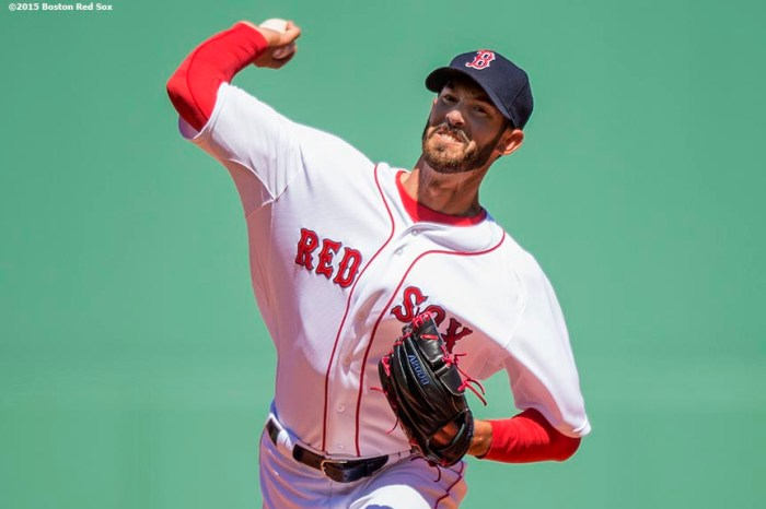 """Boston Red Sox pitcher Rick Porcello delivers during the first inning of a game against the Baltimore Orioles at Fenway Park in Boston, Massachusetts Sunday, April 19, 2015."""