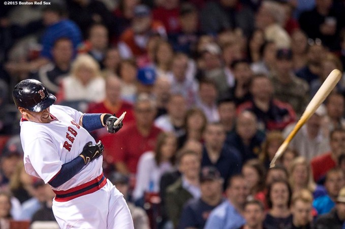 """""""Boston Red Sox left fielder Allen Craig breaks his bat as he swings during the fourth inning of a game against the Tampa Bay Rays at Fenway Park in Boston, Massachusetts Tuesday, May 5, 2015."""""""