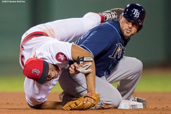 """Boston Red Sox shortstop Xander Bogaerts falls as he turns a double play during the seventh inning of a game against the Tampa Bay Rays at Fenway Park in Boston, Massachusetts Tuesday, May 5, 2015."""