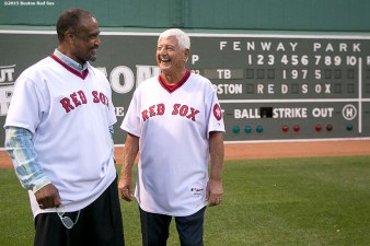 """Former Boston Red Sox left fielders Carl Yastrzemski and Jim Rice are introduced from behind the Green Monster scoreboard during a 1975 40 year reunion pre-game ceremony before a game between the Boston Red Sox and the Tampa Bay Rays at Fenway Park in Boston, Massachusetts Tuesday, May 5, 2015."""