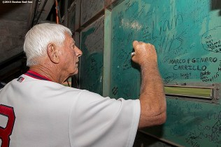"""""""Former Boston Red Sox left fielder Carl Yastrzemski signs inside the Green Monster scoreboard during a 1975 40 year reunion pre-game ceremony before a game between the Boston Red Sox and the Tampa Bay Rays at Fenway Park in Boston, Massachusetts Tuesday, May 5, 2015."""""""