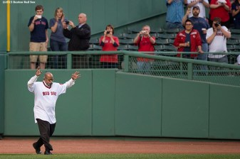 """""""Former Boston Red Sox pitcher Luis Tiant is introduced during a 1975 40 year reunion pre-game ceremony before a game between the Boston Red Sox and the Tampa Bay Rays at Fenway Park in Boston, Massachusetts Tuesday, May 5, 2015."""""""