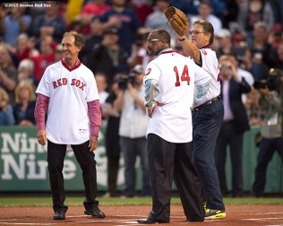 """Former Boston Red Sox outfielders Fred Lynn and Jim Rice bat as former catcher Carlton Fisk catches a ceremonial first pitch by Luis Tiant during a 1975 40 year reunion pre-game ceremony before a game between the Boston Red Sox and the Tampa Bay Rays at Fenway Park in Boston, Massachusetts Tuesday, May 5, 2015."""