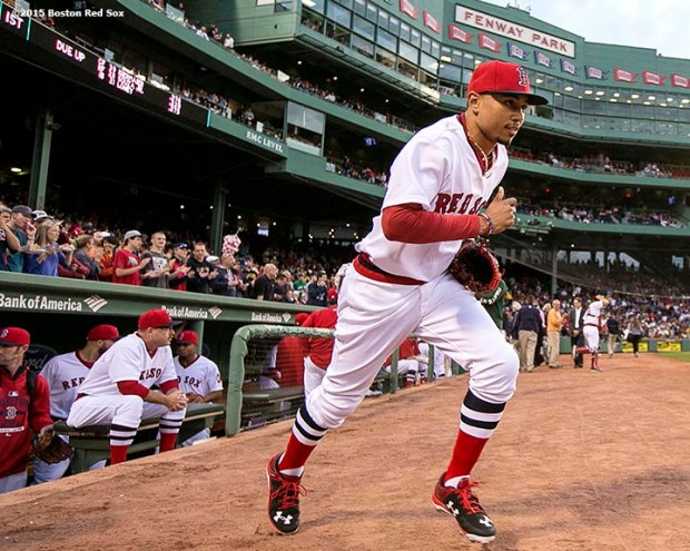 """""""Boston Red Sox center fielder Mookie Betts takes the field wearing a 1975 throwback jersey before a game against Tampa Bay Rays at Fenway Park in Boston, Massachusetts Tuesday, May 5, 2015."""""""