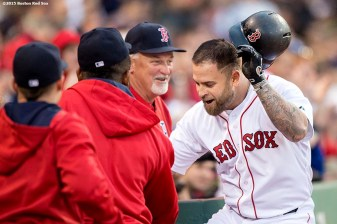 """Boston Red Sox first baseman Mike Napoli reacts after hitting a home run during the second inning of a game against the Texas Rangers at Fenway Park in Boston, Massachusetts Saturday, May 23, 2015."""