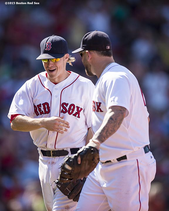 """Boston Red Sox third baseman Brock Holt and first baseman Mike Napoli react during the eighth inning of a game against the Los Angeles Angels of Anaheim at Fenway Park in Boston, Massachusetts Sunday, May 24, 2015."""