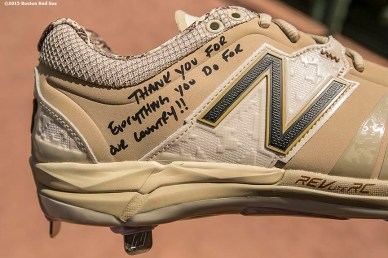 """A cleat signed by first baseman Mike Napoli is shown after he gave them away to members of the military before a game between the Boston Red Sox and the Los Angeles Angels Of Anaheim at Fenway Park in Boston, Massachusetts Sunday, May 24, 2015."""