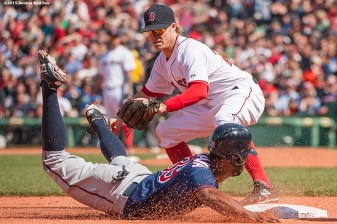 """""""Boston Red Sox third baseman Brock Holt applies a tag during the eighth inning of a game against the Minnesota Twins at Fenway Park in Boston, Massachusetts Wednesday, June 3, 2015."""""""