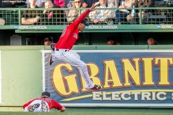 """""""Boston Red Sox center fielder Mookie Betts jumps over right fielder Brock Holt during the first inning of the second game of a day-night double header against the Minnesota Twins at Fenway Park in Boston, Massachusetts Wednesday, June 3, 2015."""""""