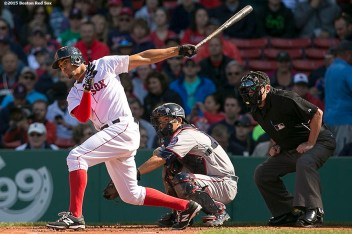 """""""Boston Red Sox shortstop Xander Bogaerts hits a single during a game against the Minnesota Twins at Fenway Park in Boston, Massachusetts Thursday, June 4, 2015."""""""