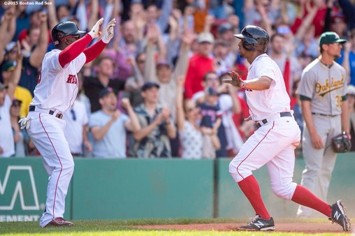 """Boston Red Sox shortstop Xander Bogaerts reacts as he scores during the inning of a game against the Oakland Athletics at Fenway Park in Boston, Massachusetts Sunday, June 7, 2015."""