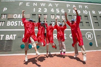 """Members of the Red Sox Scholars program pose for a group photograph in front of the Green Monster before a game between the Boston Red Sox and the Oakland Athletics at Fenway Park in Boston, Massachusetts Sunday, June 7, 2015."""